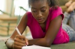 Black girl writing