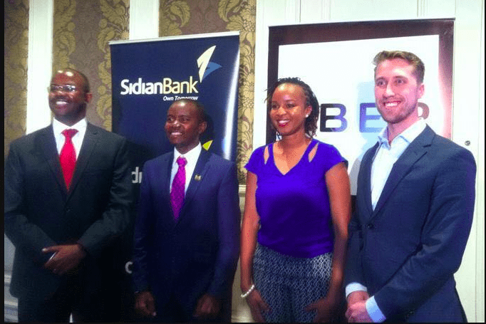 Kagure inset with the Cabinet Secretary of the ICT ministry, Joe Mucheru alongside the GMs of both Sidian Bank and Uber East Africa, during the launch of the multi-million dollar deal.